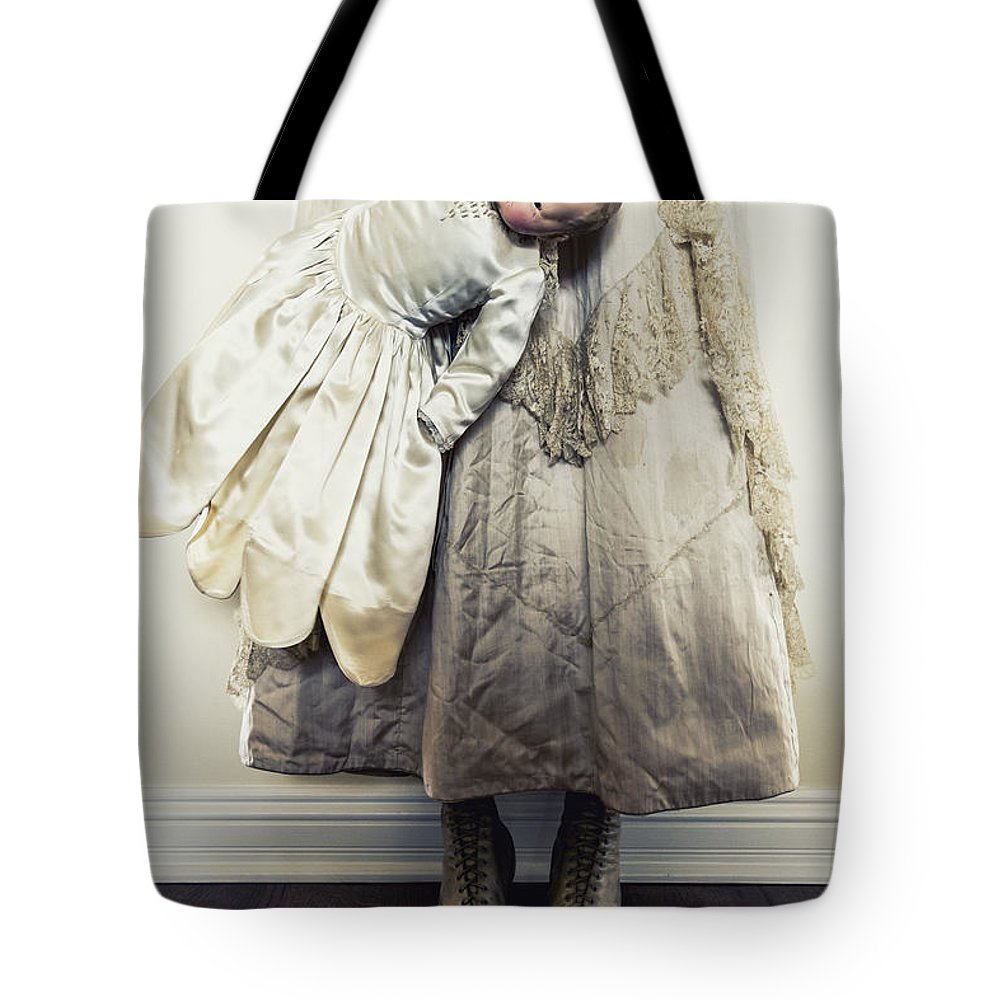 Caucasian; Female; Woman; Lady; Young Woman; Vintage; Dress; Victorian; Prim; Proper; Feminine; Beautiful; Pretty; Lovely; Indoors; Inside; Ornate; Cream; Doll; Baby; Toy; Broken; Arm; Feet; Boots; Antique; Cracked; Wood; Wooden; Porcelain; Hold; Holding; Creepy; Weird; Scary Tote Bag featuring the photograph Hand Holding by Margie Hurwich