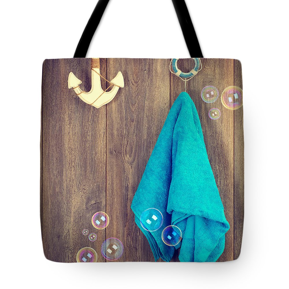Towel Tote Bag featuring the photograph Hanging Towel by Amanda Elwell