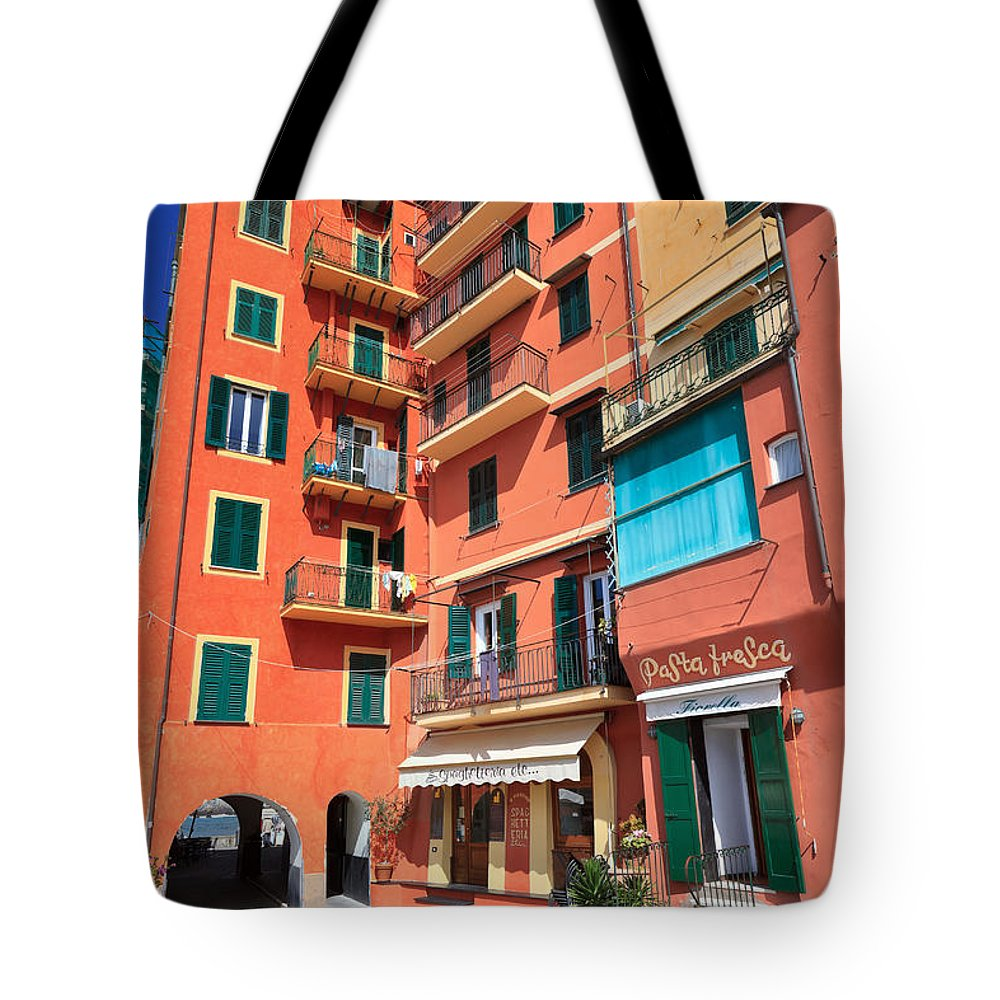 Ancient Tote Bag featuring the photograph homes and promenade in Camogli by Antonio Scarpi