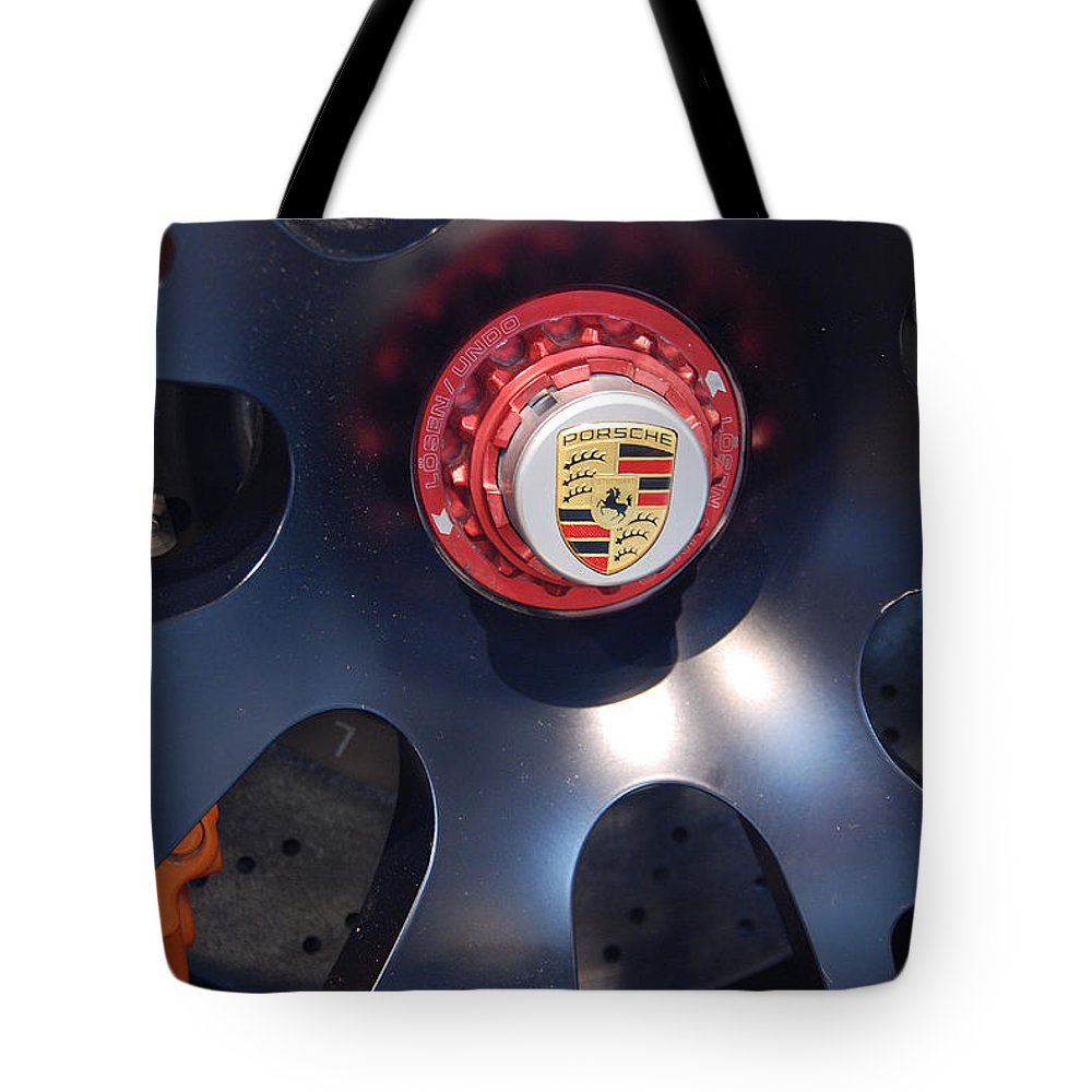 Automotive Details Tote Bag featuring the photograph Hybrid Wheel by John Schneider
