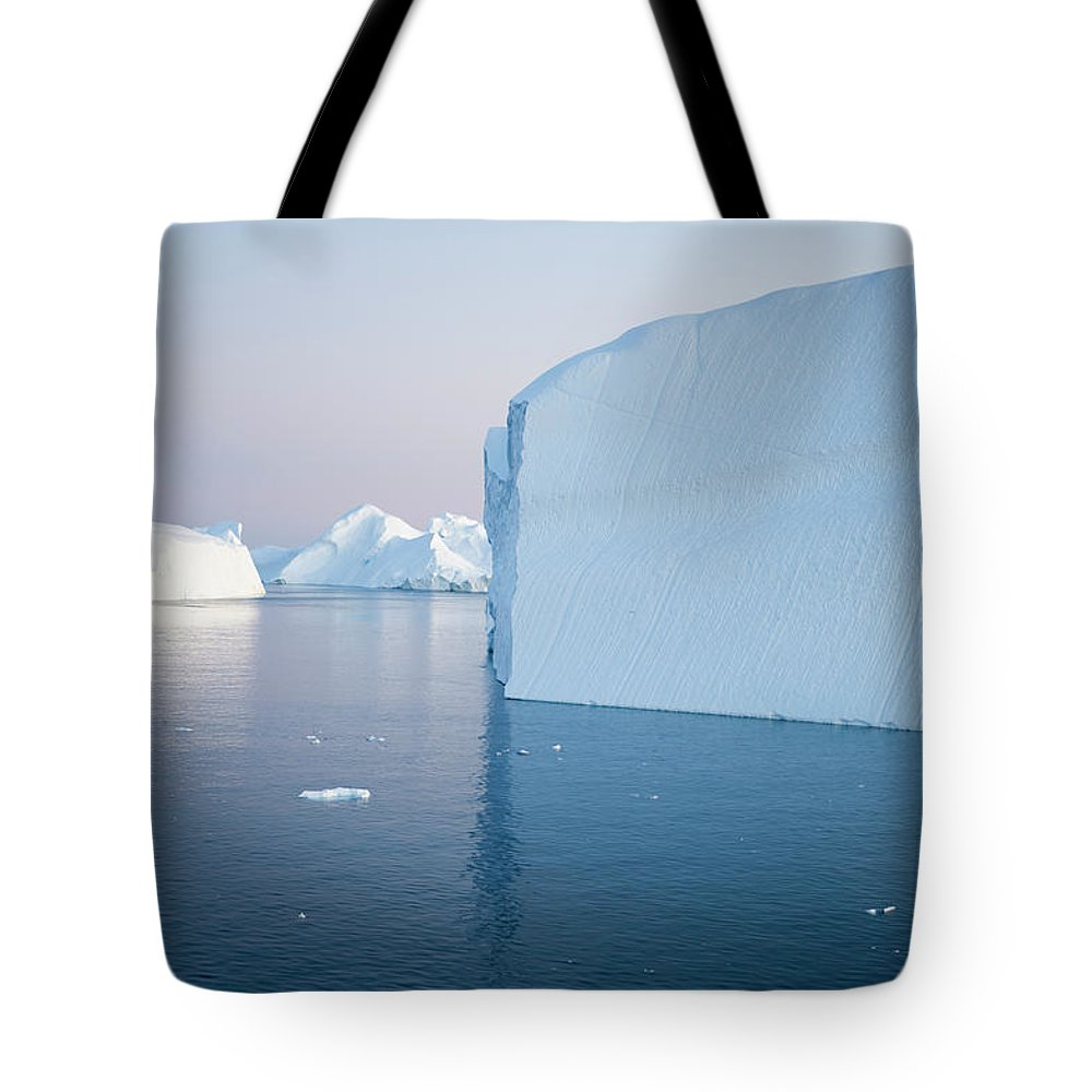 Melting Tote Bag featuring the photograph Icebergs Of Ilulissat Kangerlua by Holger Leue