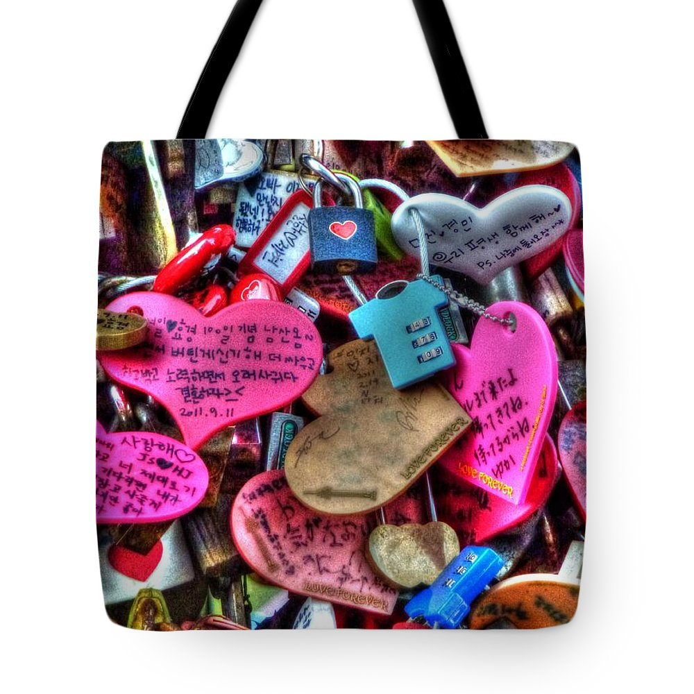 If Tote Bag featuring the photograph If You Love It Lock It by Michael Garyet