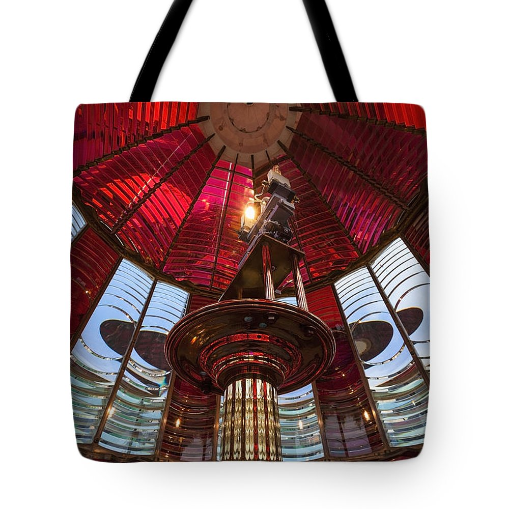 Bright Color Tote Bag featuring the photograph Interior Of Fresnel Lens In Umpqua Lighthouse by Bryan Mullennix