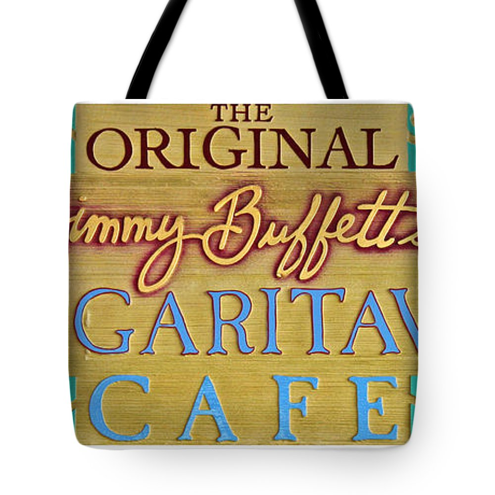 Jimmy Buffett Tote Bag featuring the photograph Jimmy Buffetts Margaritaville Cafe Sign The Original by John Stephens