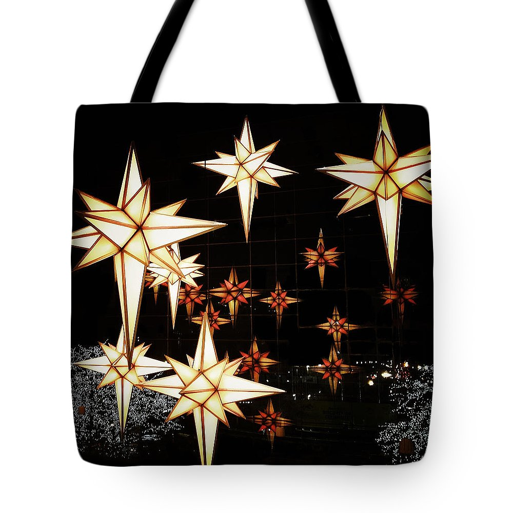 Lights Tote Bag featuring the photograph Joy To The World by Natasha Marco
