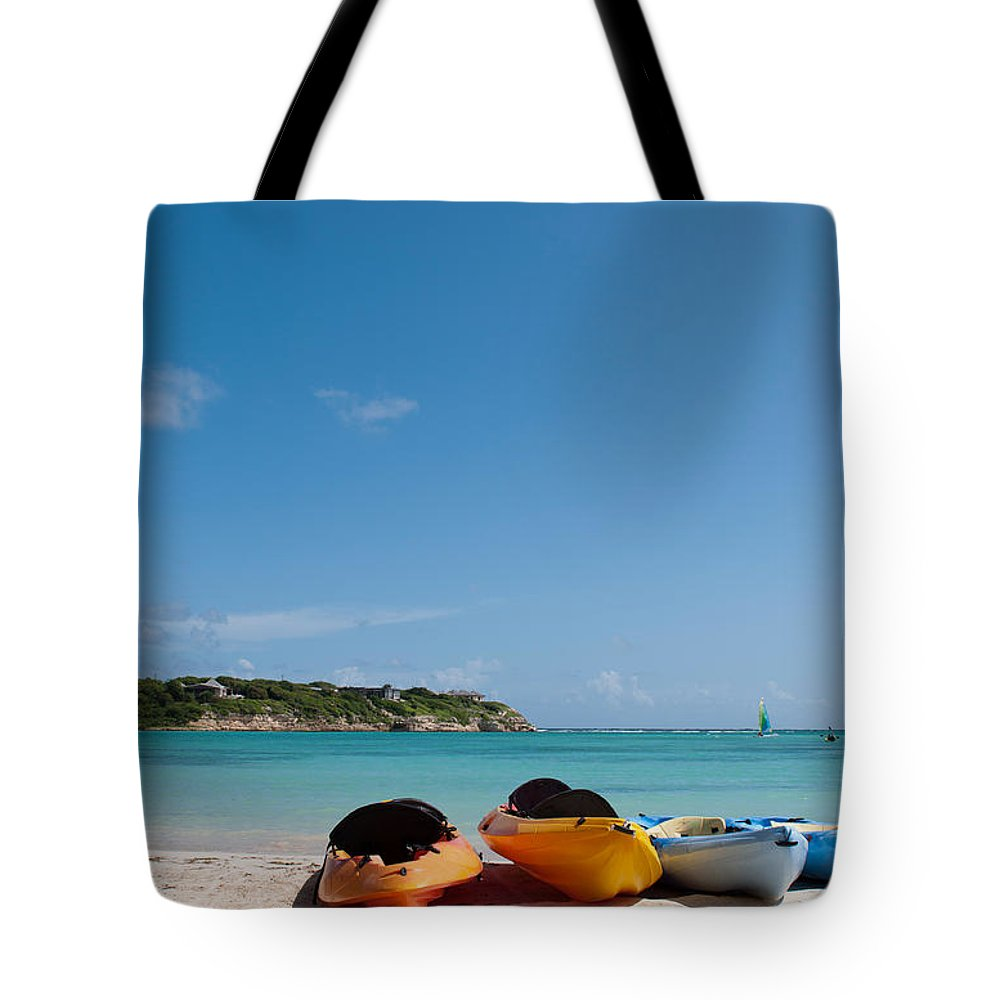 Beach Tote Bag featuring the photograph Kayaks On Beach by Luis Alvarenga