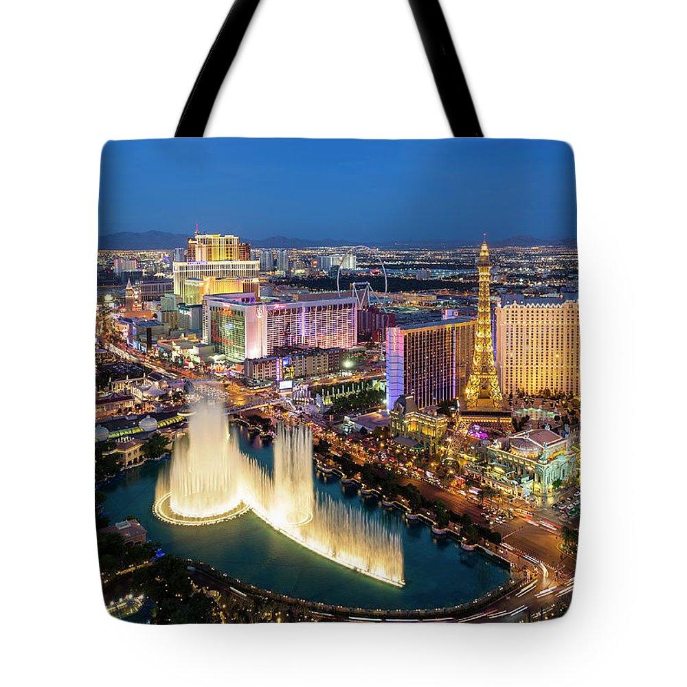 Las Vegas Replica Eiffel Tower Tote Bag featuring the photograph Las Vegas Skyline At Dusk by Sylvain Sonnet