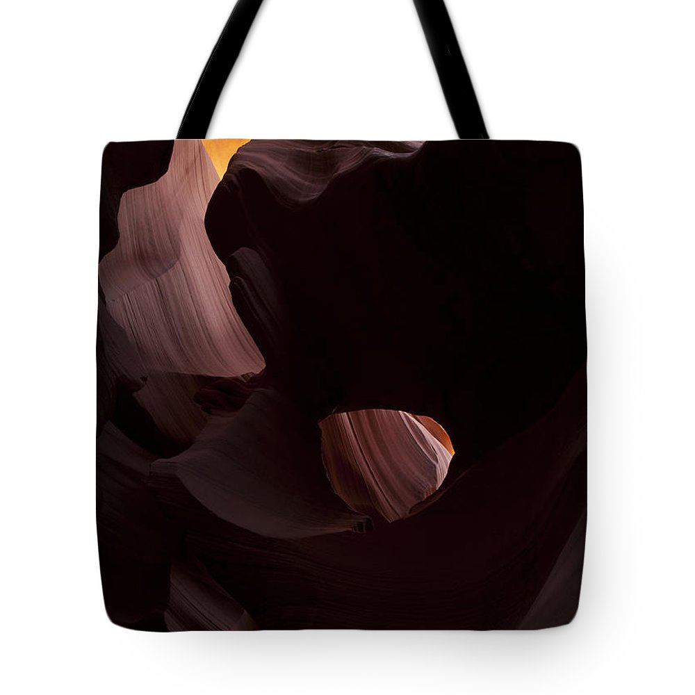 Eye Of The Needle Tote Bag featuring the photograph Light In The Eye by Mike Dawson