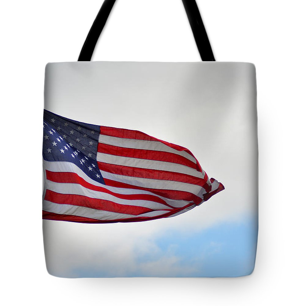 Long Tote Bag featuring the photograph Long May You Wave by Bill Cannon