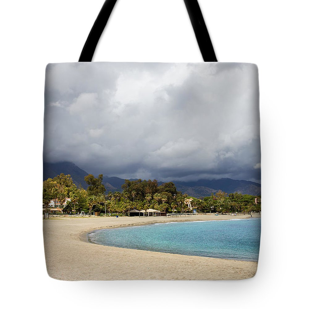Marbella Tote Bag featuring the photograph Marbella Beach by Artur Bogacki