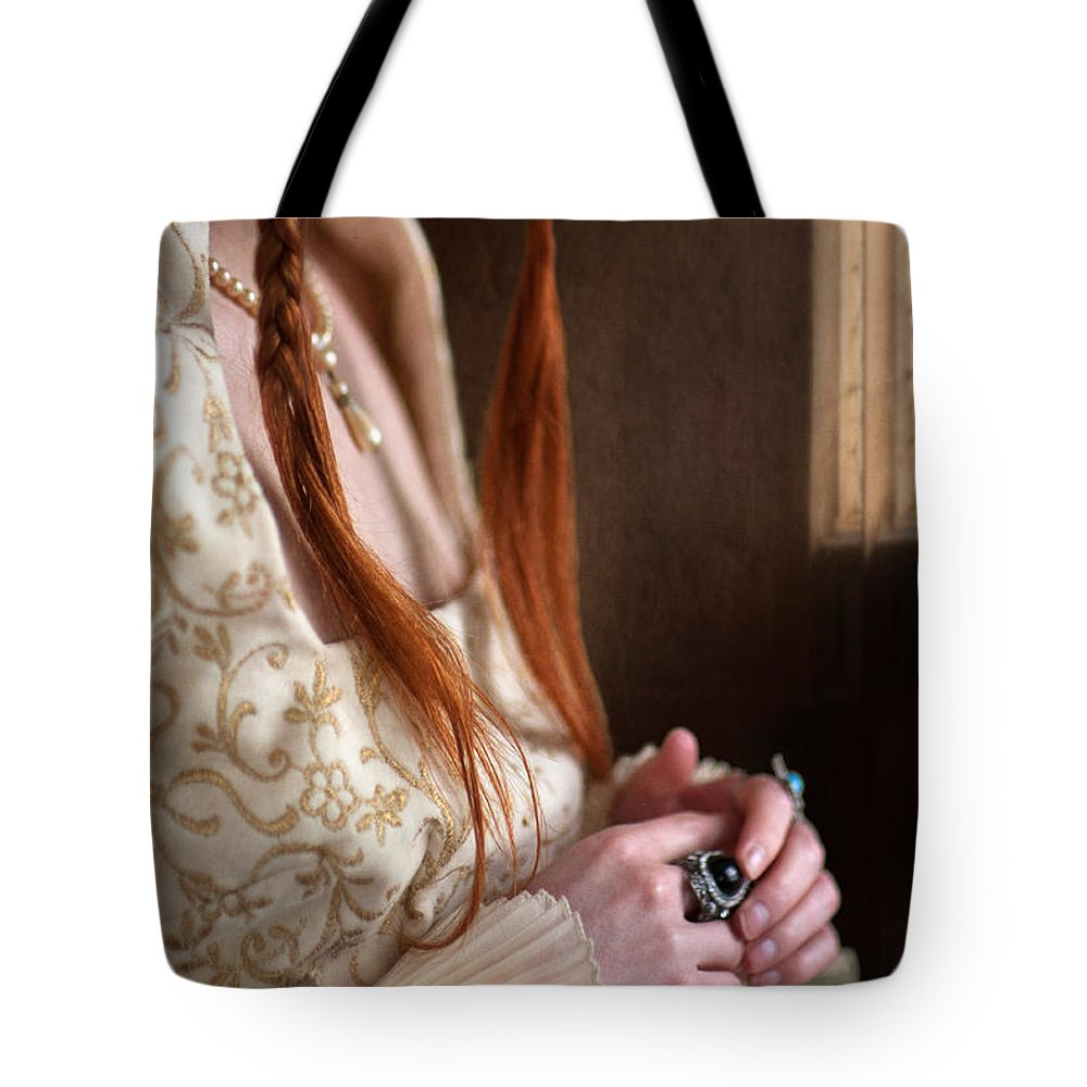 Medieval Tote Bag featuring the photograph Medieval Tudor Woman With Red Hair by Lee Avison