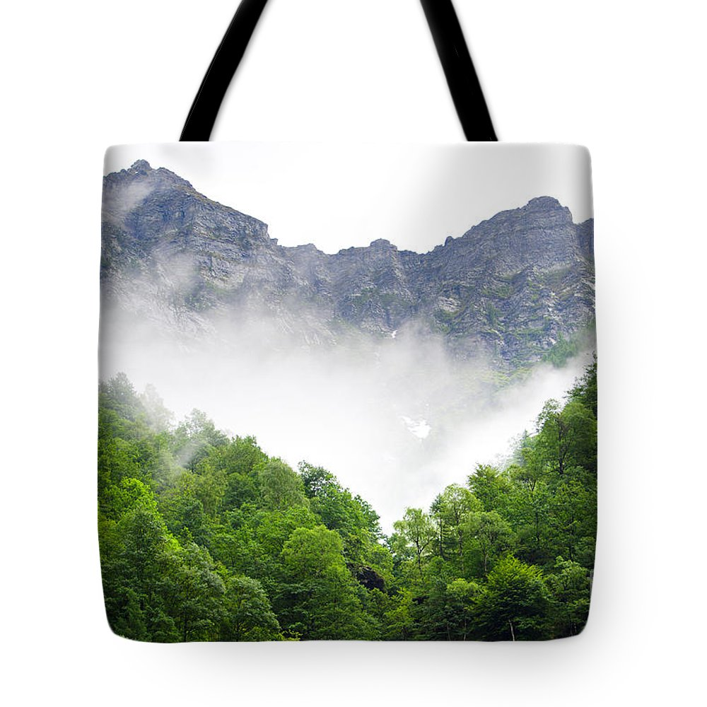 Mountain Tote Bag featuring the photograph Mountain With Clouds by Mats Silvan