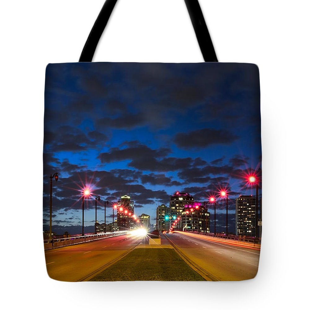 Clouds Tote Bag featuring the photograph Night Lights by Debra and Dave Vanderlaan