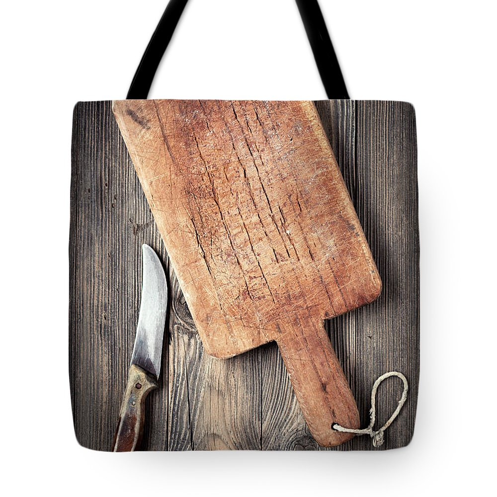 Empty Tote Bag featuring the photograph Old Cutting Board And Knife by Barcin