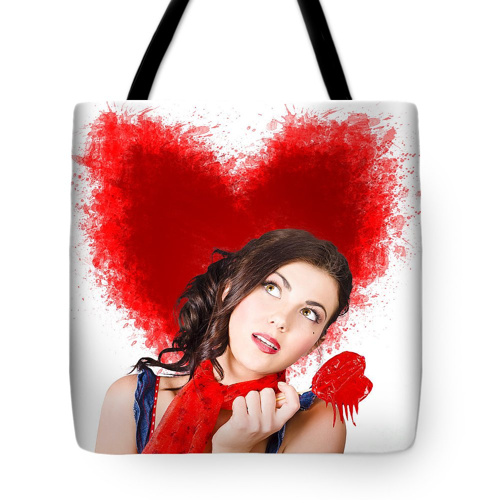 Woman Tote Bag featuring the photograph Photo Of Romantic Woman Holding Heart Shape Candy by Jorgo Photography - Wall Art Gallery