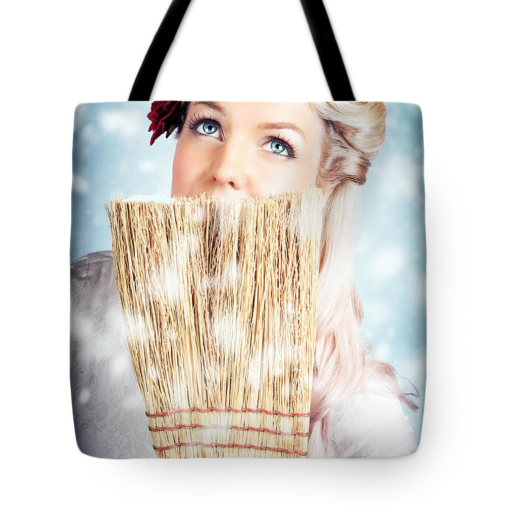 1960 Tote Bag featuring the photograph Pin-up Woman Cleaning Up In Cold Blue Winter Snow by Jorgo Photography - Wall Art Gallery