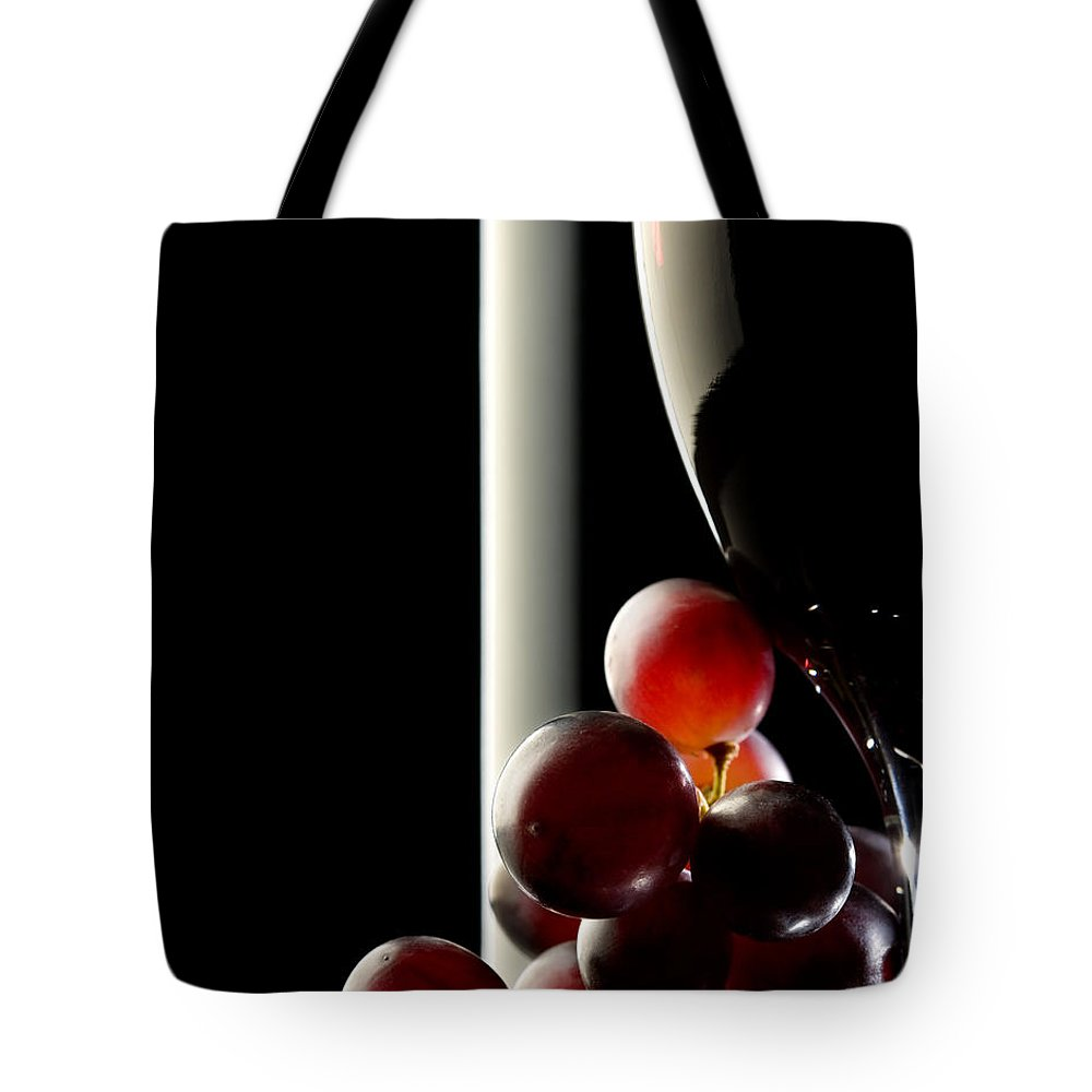 Reflection Tote Bag featuring the photograph Red Wine With Grapes by Johan Swanepoel