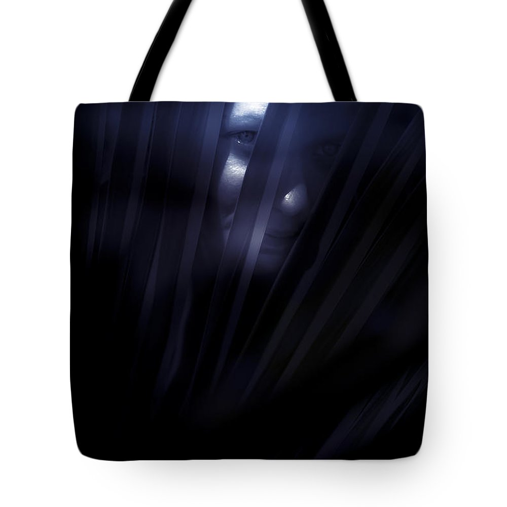 Alone Tote Bag featuring the photograph Shadowed Woman Behind Frond by Jorgo Photography - Wall Art Gallery