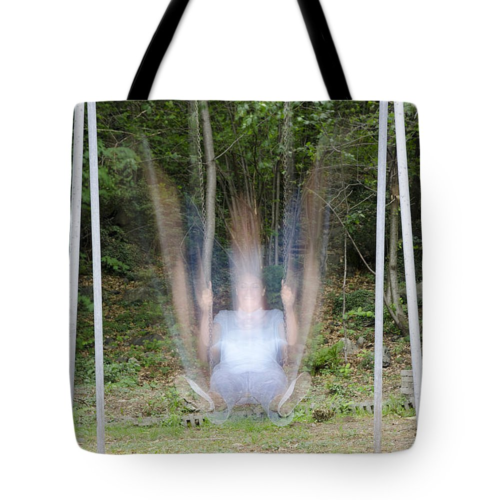 Woman Tote Bag featuring the photograph Swing by Mats Silvan