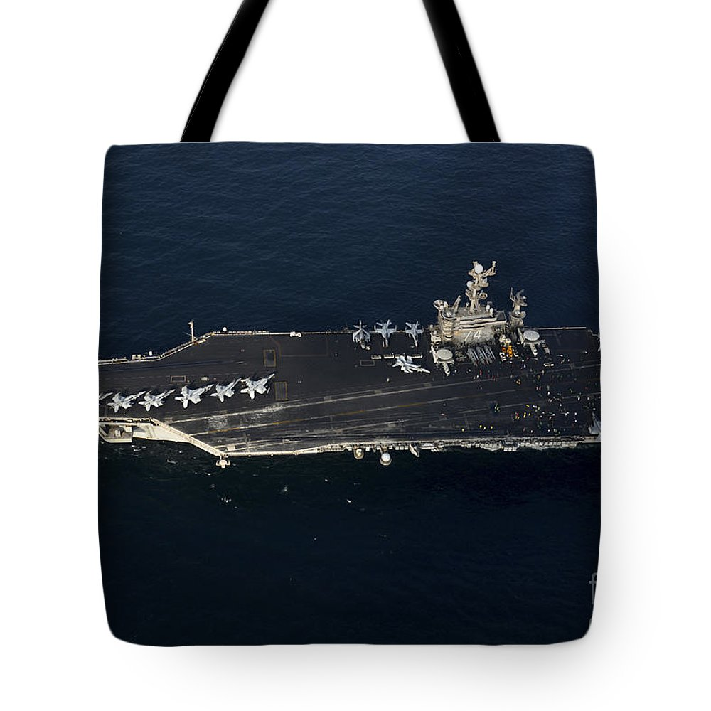 Military Tote Bag featuring the photograph The Aircraft Carrier Uss John C by Stocktrek Images