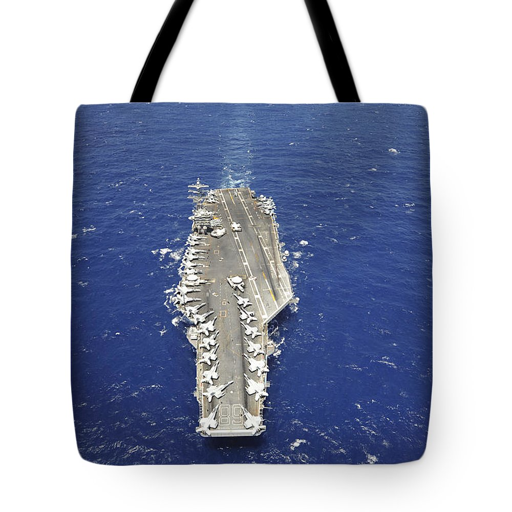 Rimpac Tote Bag featuring the photograph The Aircraft Carrier Uss Nimitz by Stocktrek Images