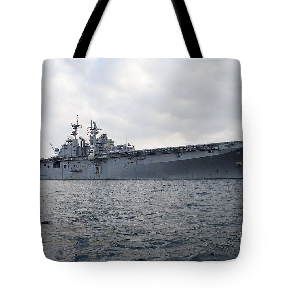 Military Tote Bag featuring the photograph The Amphibious Assault Ship Uss by Stocktrek Images