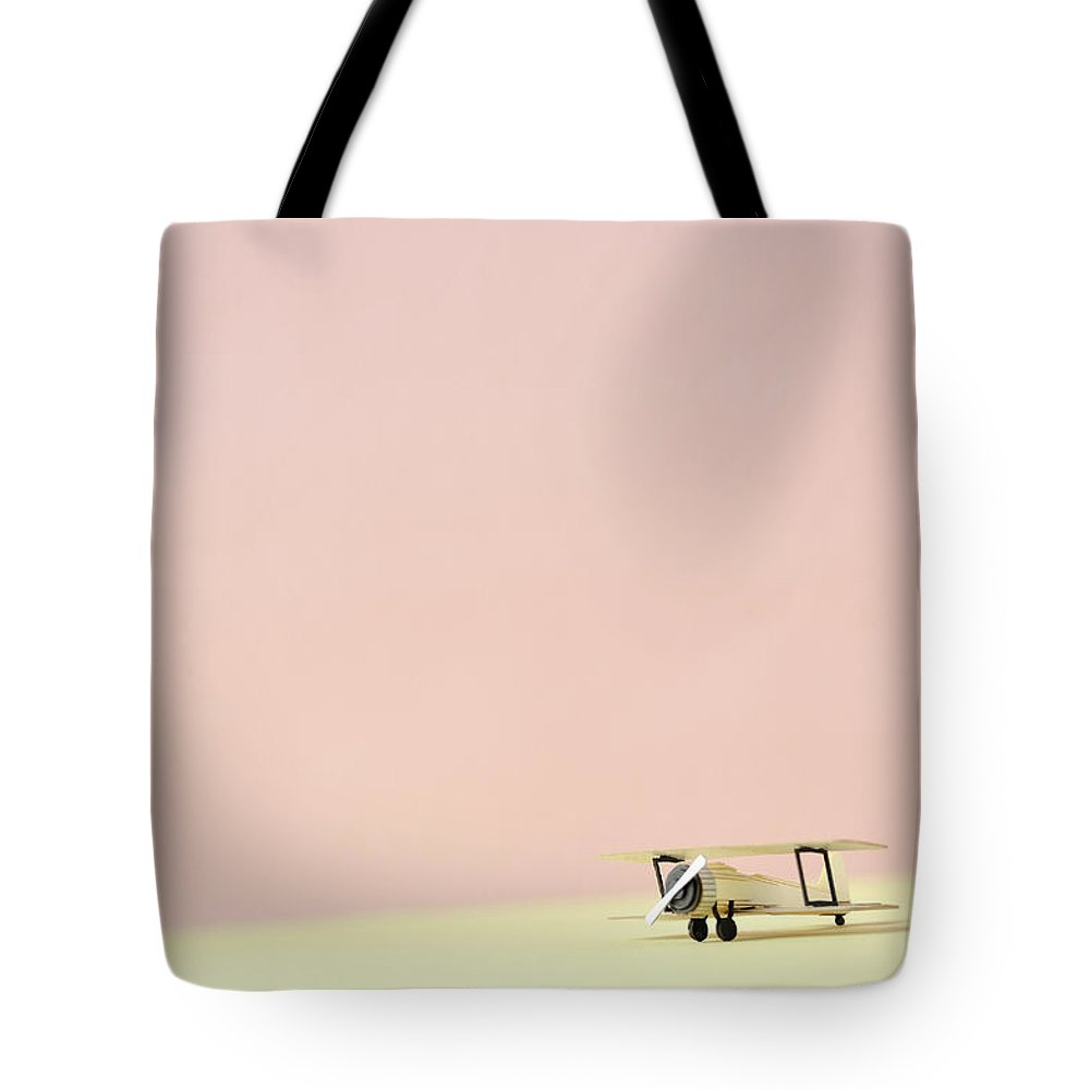 Shadow Tote Bag featuring the photograph The Model Of The Airplane Made Of The by Yagi Studio