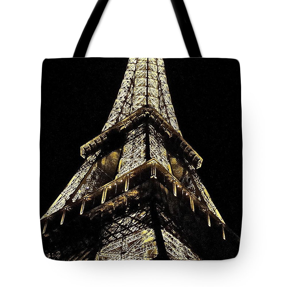 Eiffel Tower At Night Tote Bag featuring the photograph tour Eiffel by Brad Gravelle