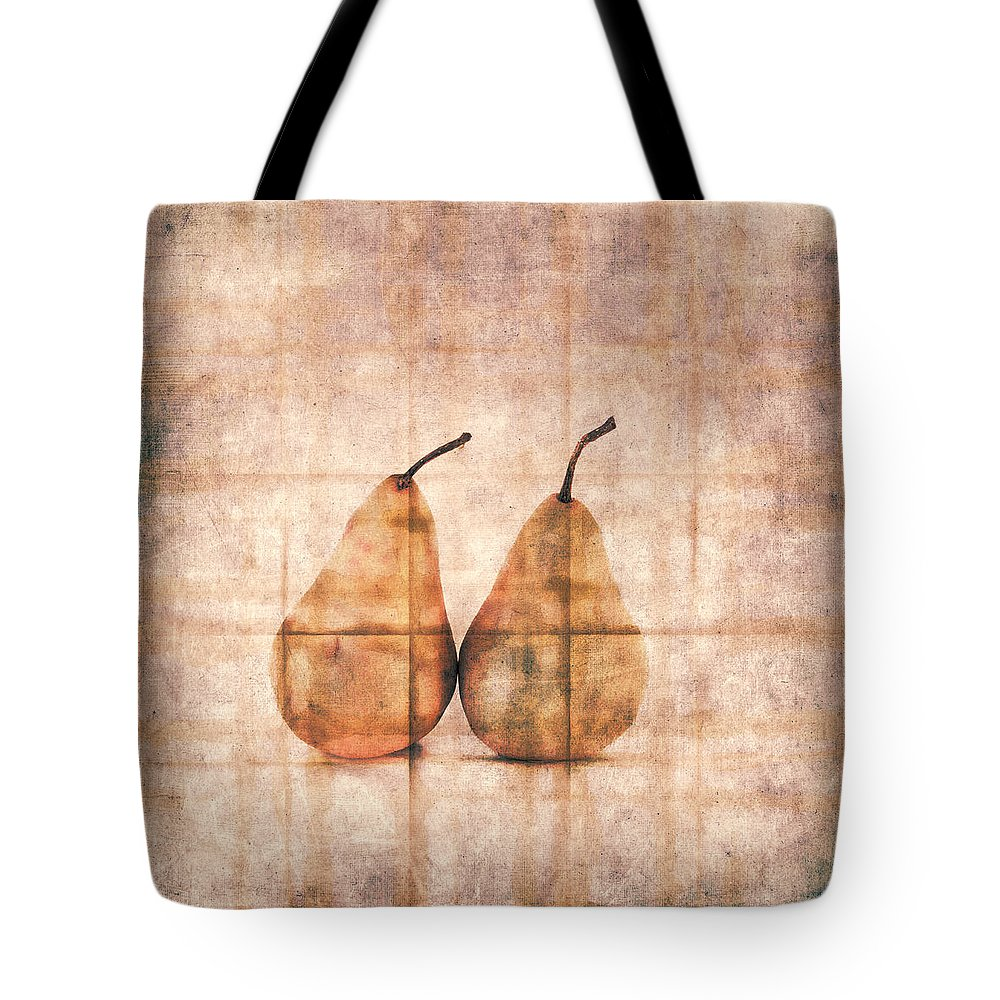 Two Tote Bag featuring the photograph Two Yellow Pears on Folded Linen by Carol Leigh