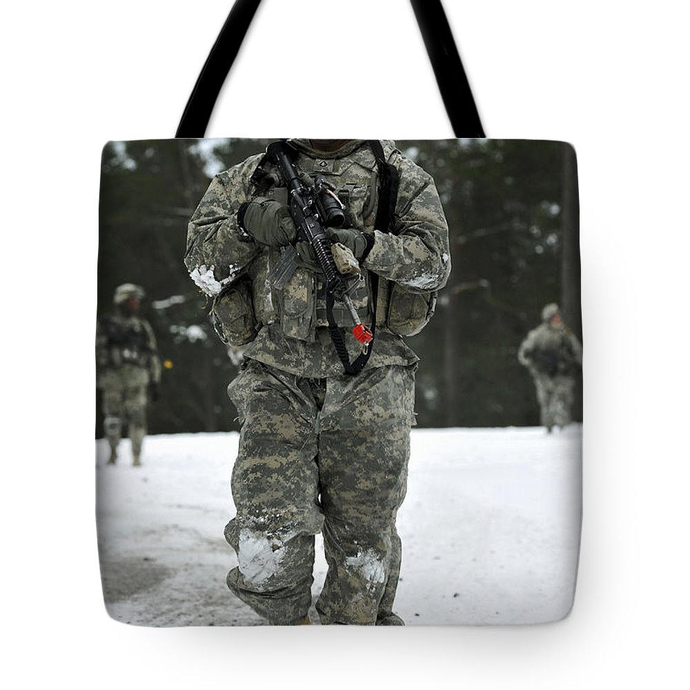 Grafenwoehr Training Area Tote Bag featuring the photograph U.s. Army Soldier Conducts A Dismounted by Stocktrek Images