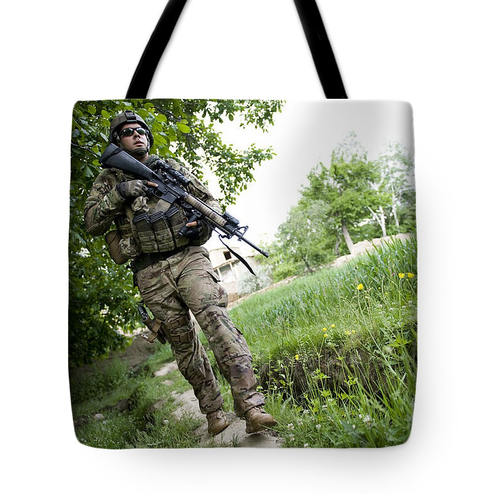 Middle East Tote Bag featuring the photograph U.s. Army Specialist Walks by Stocktrek Images