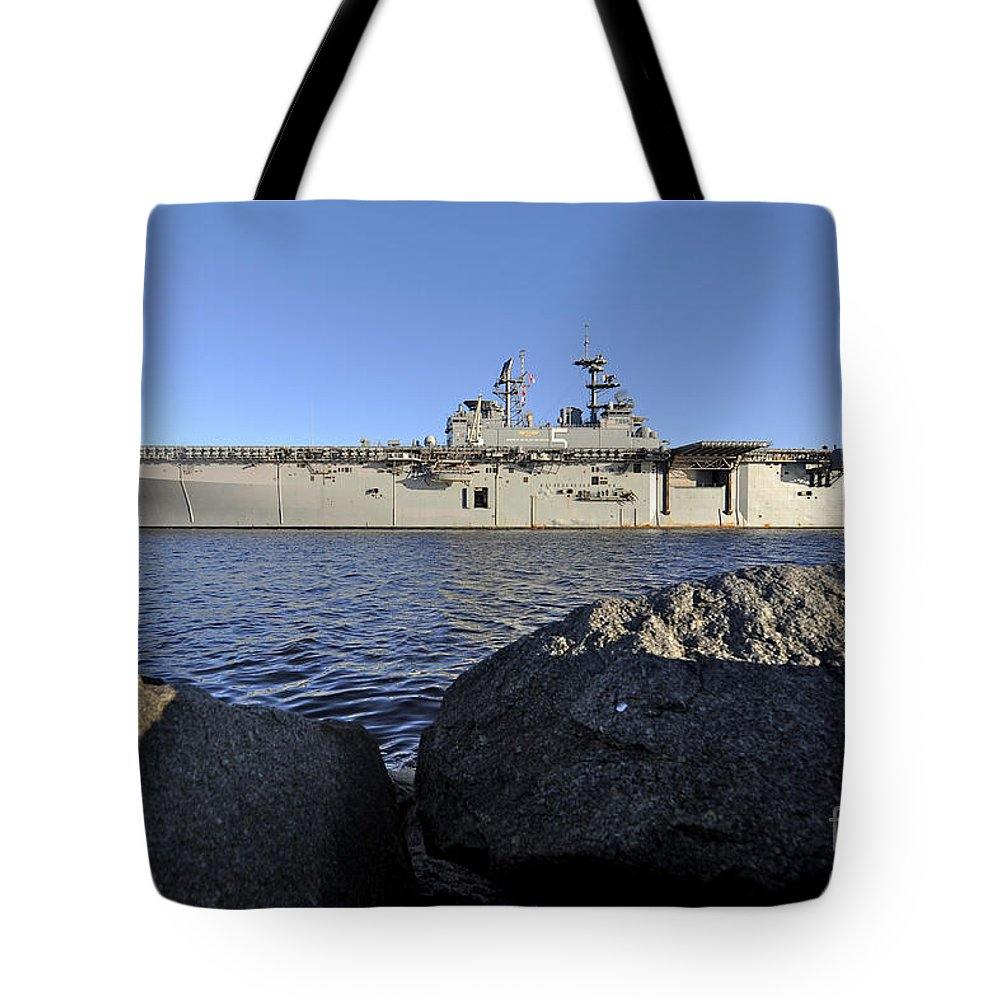 Navy Tote Bag featuring the photograph Uss Bataan Arrives At Naval Station by Stocktrek Images
