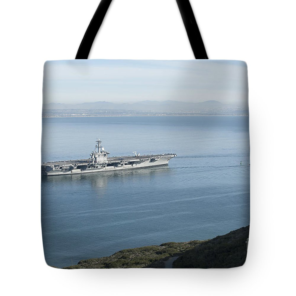 Military Tote Bag featuring the photograph Uss Carl Vinson Gets Underway by Stocktrek Images