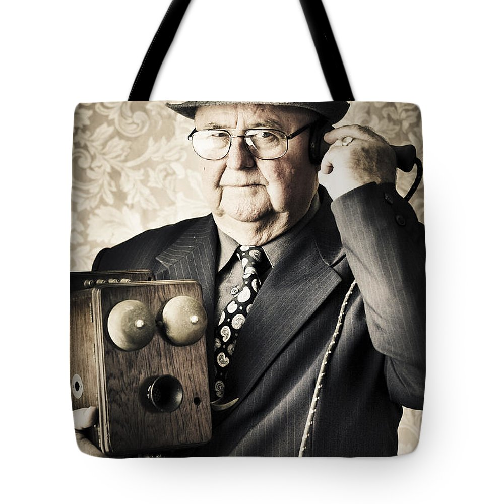 Audio Tote Bag featuring the photograph Vintage Business Man Using Retro Telephone by Jorgo Photography - Wall Art Gallery