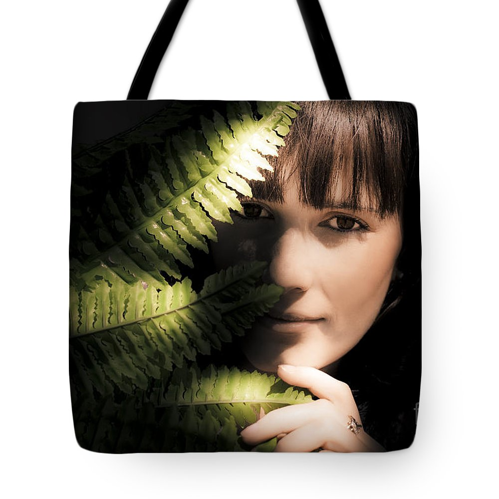 Adult Tote Bag featuring the photograph Woman Hiding Behind Fern Leaf by Jorgo Photography - Wall Art Gallery