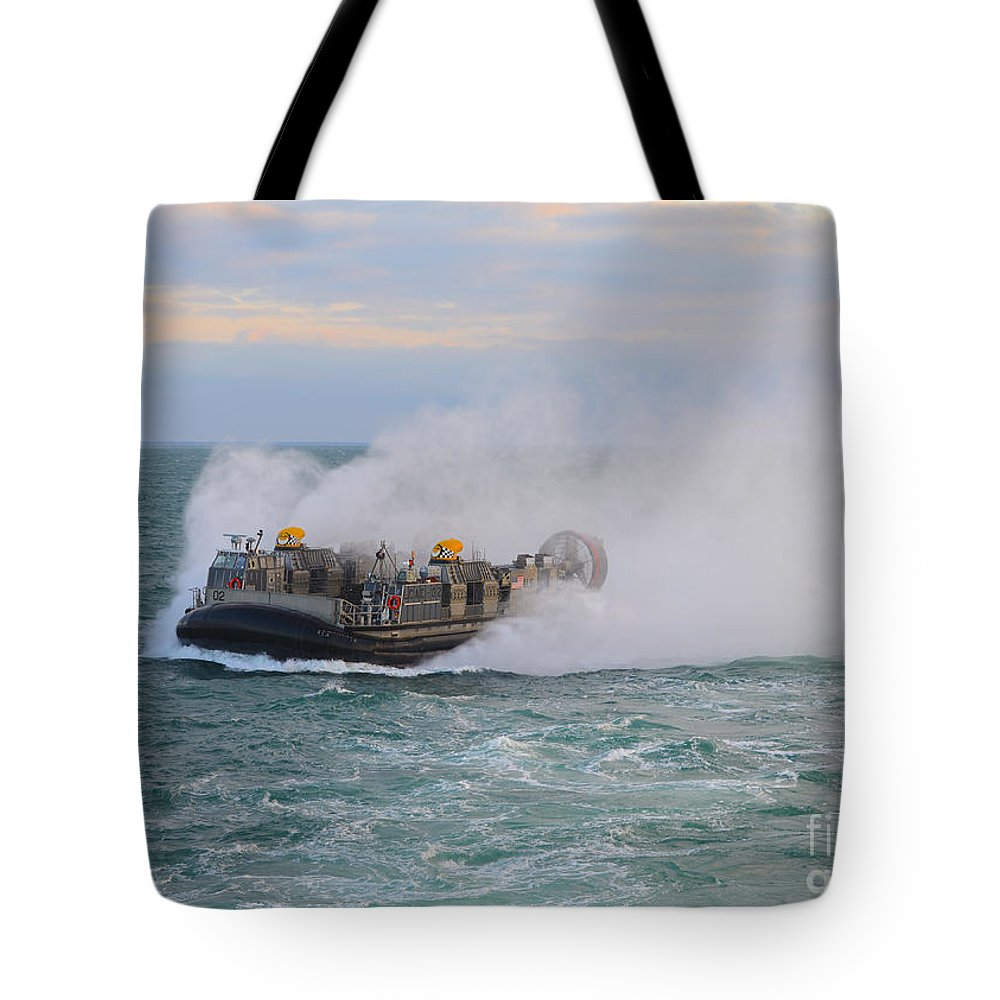 Military Tote Bag featuring the photograph A Landing Craft Air Cushion Transits by Stocktrek Images