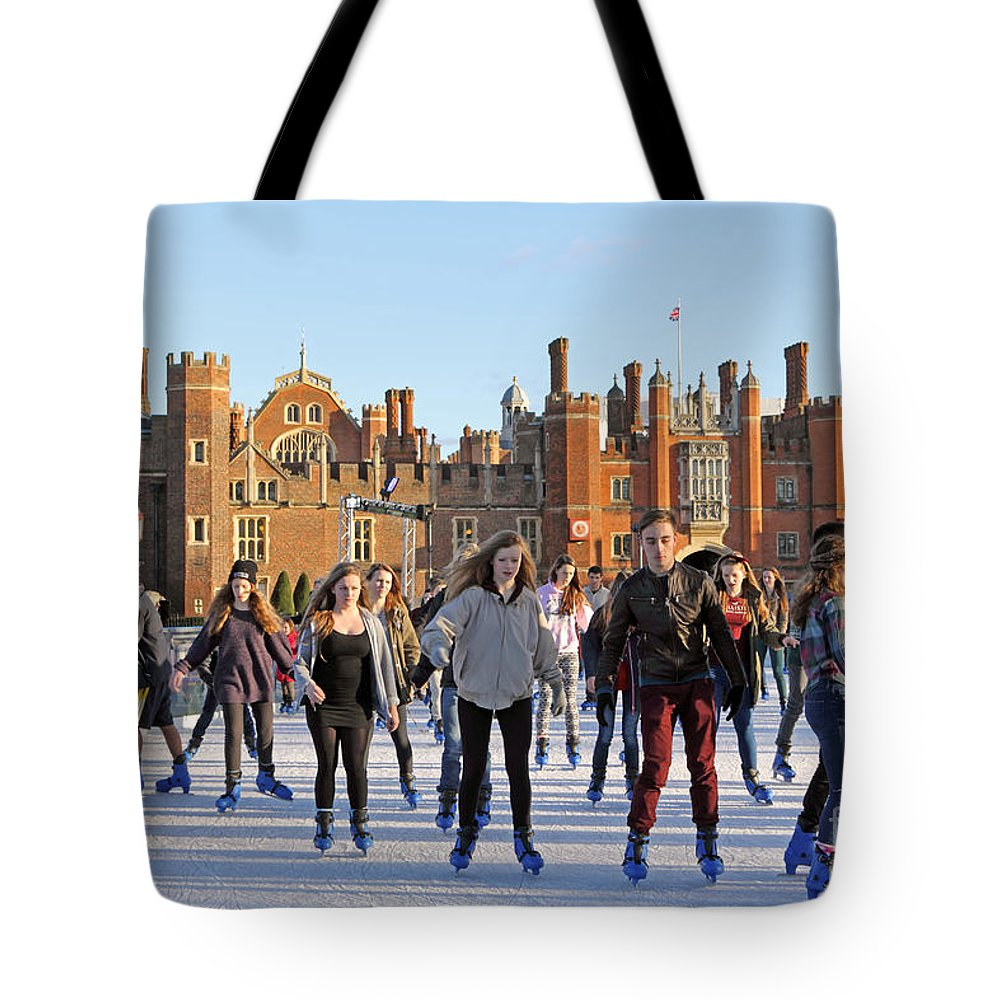 Ice Skating At Hampton Court Palace Ice Rink England Uk Tote Bag featuring the photograph Ice Skating At Hampton Court Palace Ice Rink England Uk by Julia Gavin