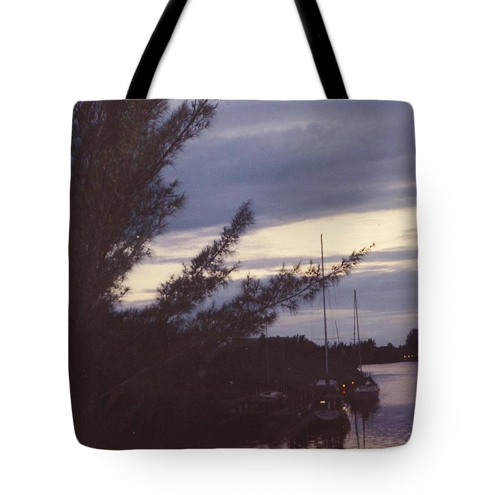 Gray Skys And Lighted Sail Boats Tote Bag featuring the photograph Skyscape by Robert Floyd