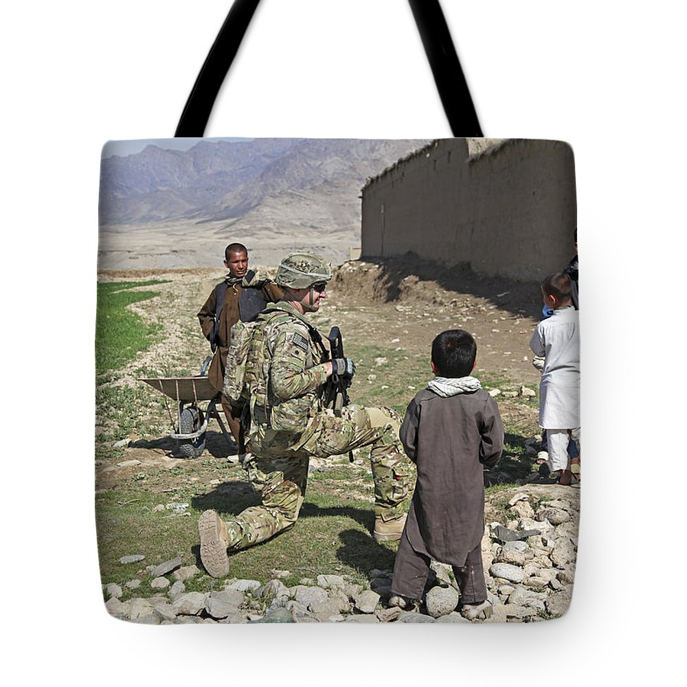 Afghanistan Tote Bag featuring the photograph U.s. Army Soldier Provides Security by Stocktrek Images