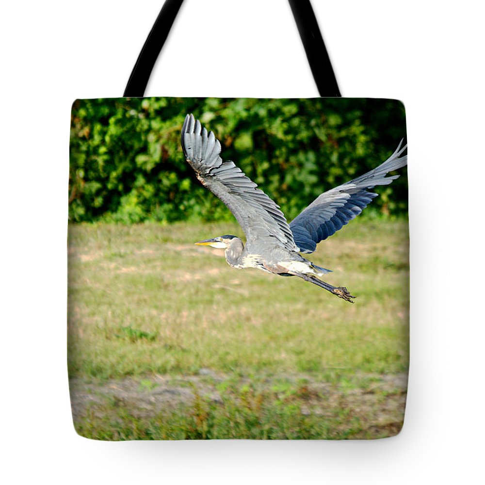Roy Williams Tote Bag featuring the photograph Great Blue Heron In Flight by Roy Williams