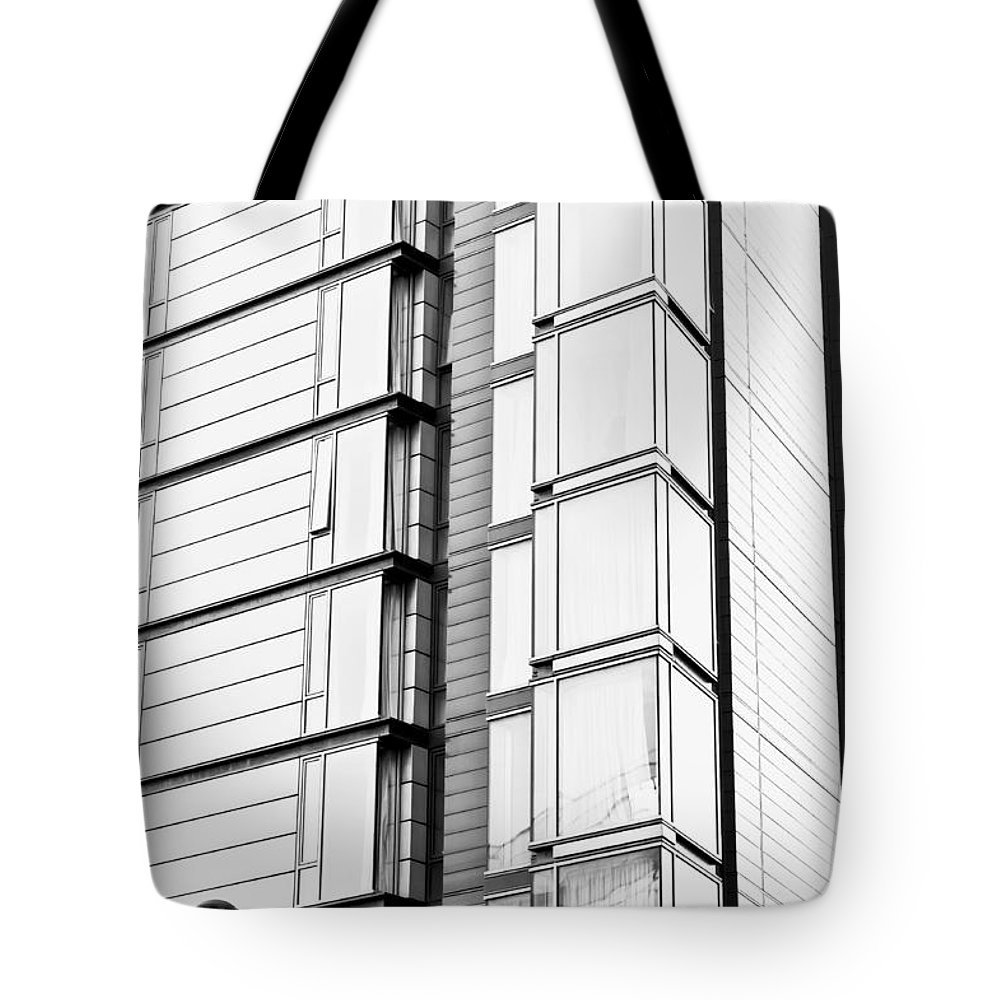 Abstract Tote Bag featuring the photograph Modern Building by Tom Gowanlock