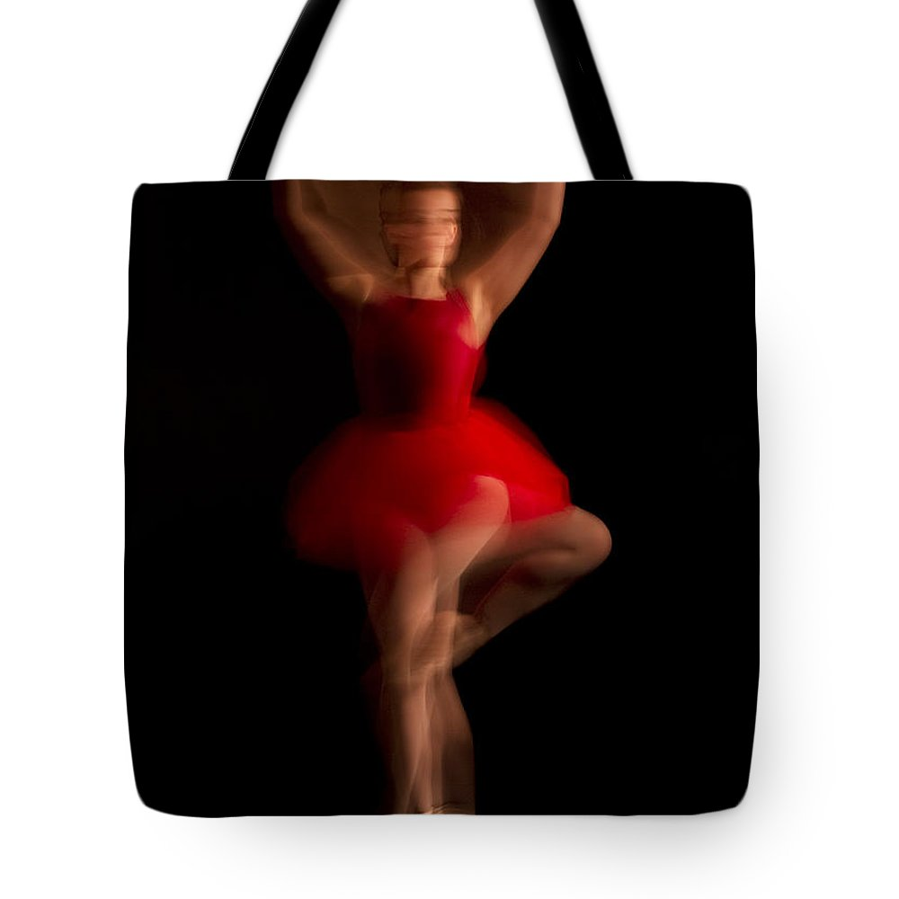 Lisa Cockrell Tote Bag featuring the photograph Ballet Dancer In Red Tutu by Lisa Cockrell