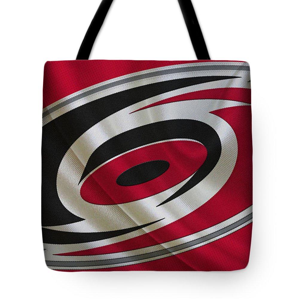 Hurricanes Tote Bag featuring the photograph Carolina Hurricanes by Joe Hamilton
