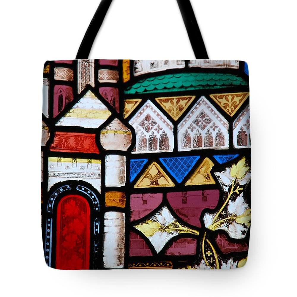 Church Tote Bag featuring the photograph Religious Stained Glass Window by Luis Alvarenga