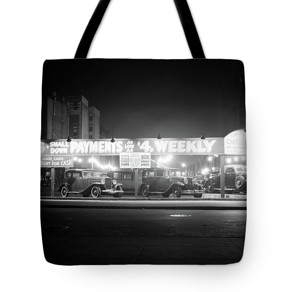 Photography Tote Bag featuring the photograph 1930s New And Used Car Lot At Night by Vintage Images