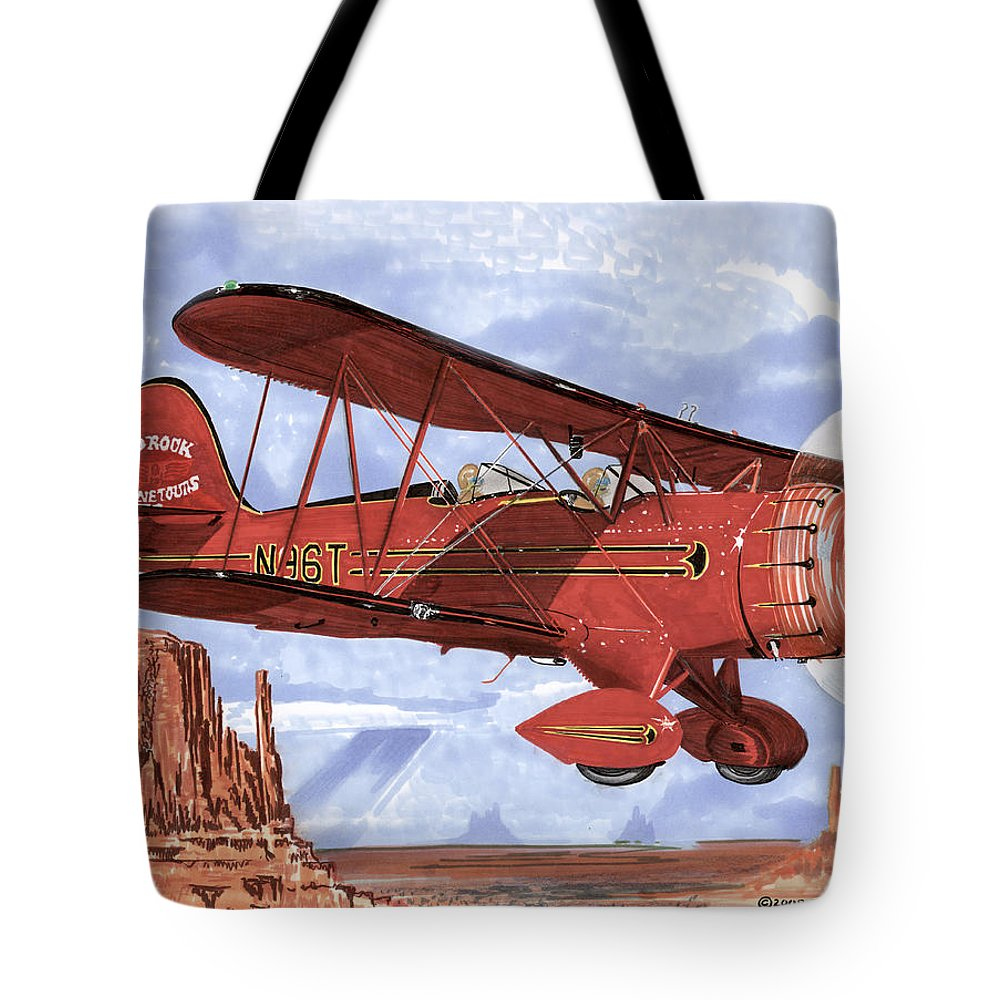 1935 Waco Bi-plane. Framed Prints Of Bi-wing Aircraft. Post Cards Of Old Airplanes. Framed Prints Of Utah Tote Bag featuring the painting Monument Valley Bi-plane by Jack Pumphrey
