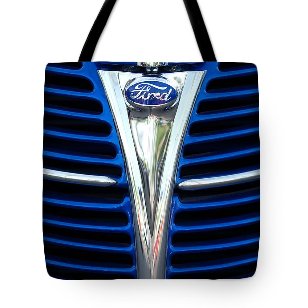 1939 Ford Woody Wagon Grille Emblem Tote Bag featuring the photograph 1939 Ford Woody Wagon Grille Emblem by Jill Reger