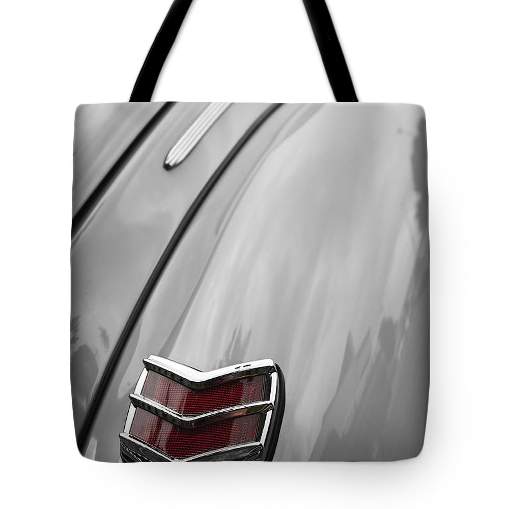 Ford Tote Bag featuring the photograph 1940 Ford Taillight by Dennis Hedberg