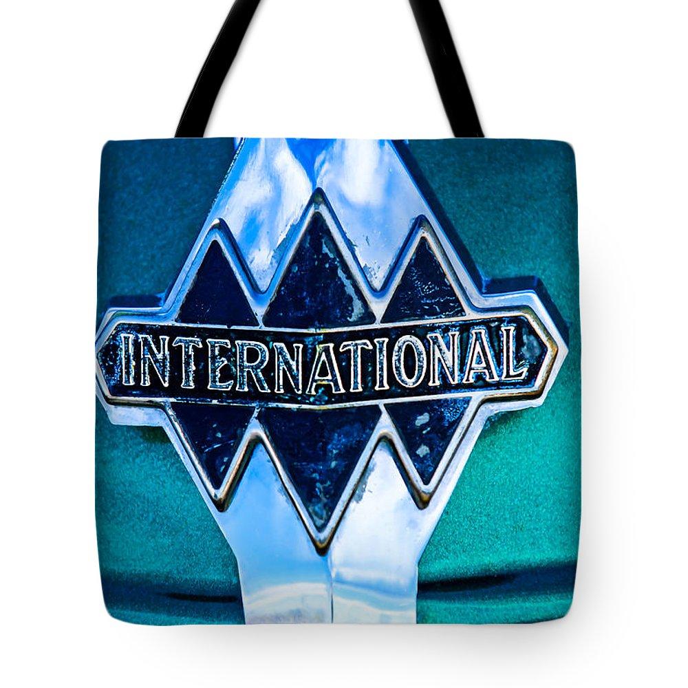 1940 International Tote Bag featuring the photograph 1940 International Emblem by Jill Reger