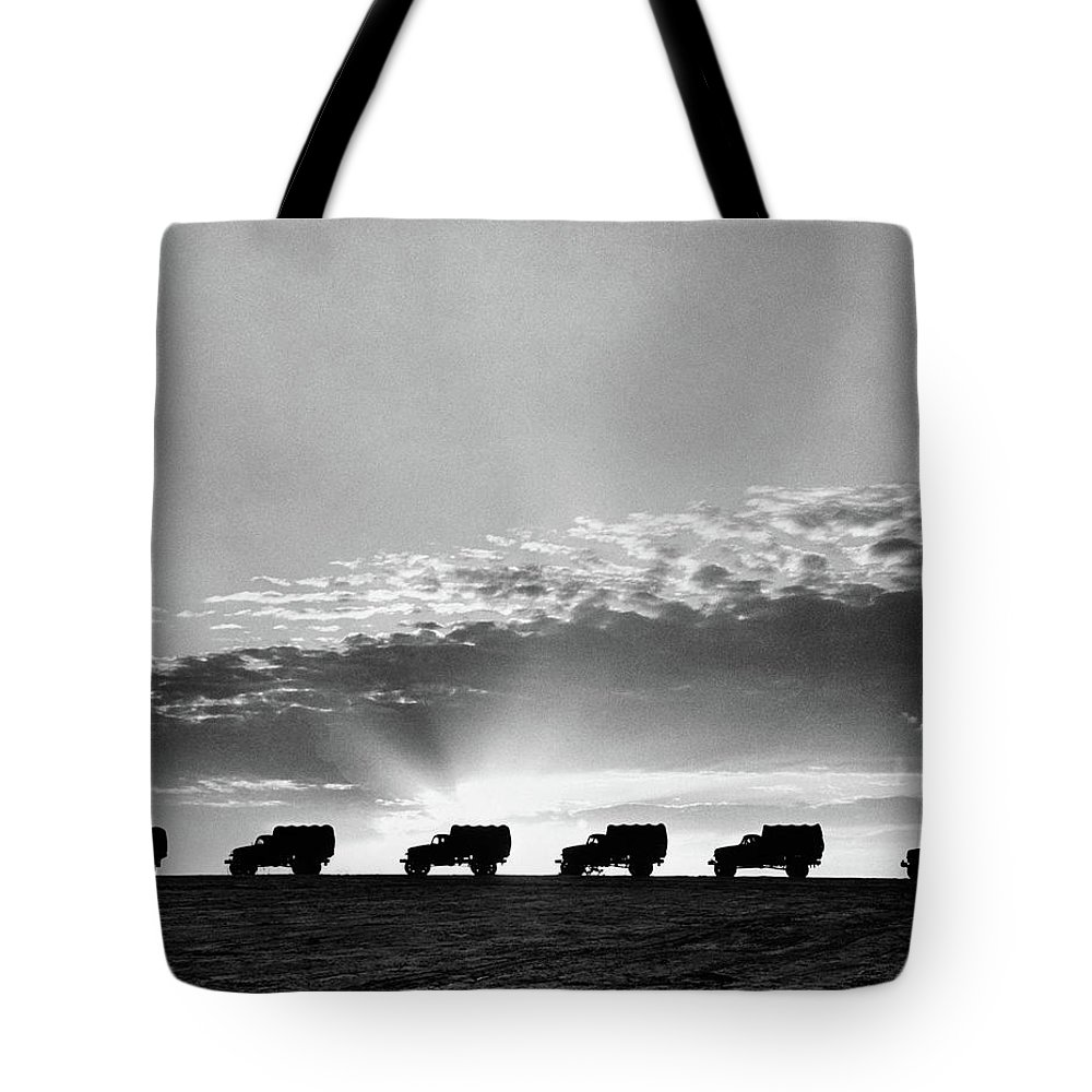 Photography Tote Bag featuring the photograph 1940s Line Of Anonymous Silhouetted by Vintage Images